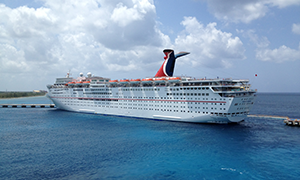"© <a href=""https://commons.wikimedia.org/wiki/File:Carnival_Paradise_Docked_In_Cozumel,Mexico.jpg"" target=""_blank"" rel=""nofollow"">Jacrews7/Wikimedia</a>/<a href=""https://creativecommons.org/licenses/by/2.0/deed.en"" target=""_blank"" rel=""nofollow"">CC BY 2.0</a>"