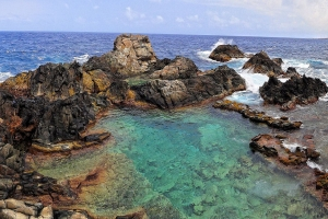 "© <a href=""https://commons.wikimedia.org/wiki/File:Aruba-Natural-Pool-2013.JPG"" target=""_blank"" rel=""nofollow"">Bjørn Christian Tørrissen/Wikimedia</a>/<a href=""https://creativecommons.org/licenses/by-sa/3.0/deed.en"" target=""_blank"" rel=""nofollow"">CC BY-SA 3.0</a>"
