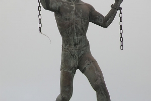 """© <a href=""""https://commons.wikimedia.org/wiki/File:Bussa_statue.png"""" target=""""_blank"""" rel=""""nofollow"""">Dogfacebob/Wikimedia</a>/Public domain"""